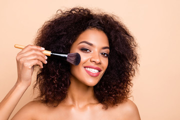 Close up photo beautiful she her dark skin model lady brunette wavy hairdo aesthetic look toothy mouth make maquillage use new professional brush toothy nude isolated pastel beige background