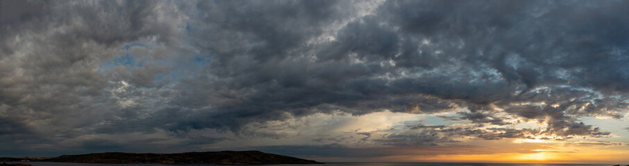 Sunset panorama over sea Beautiful cloudscape over the sea, sunrise / sunrise
