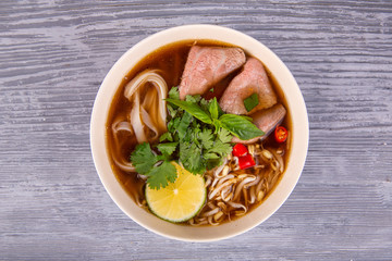 Soup with vermichel, noodles and pieces of meat