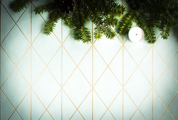 A festive, geometric background in a color of paslet blue with branches of a Christmas tree and a candle with free space for text. Merry Christmas 2019