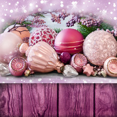 Various Christmas decorations and wooden background