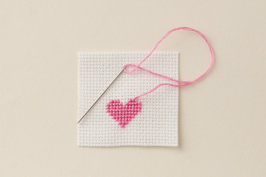 cross-stitch heart with needle and thread