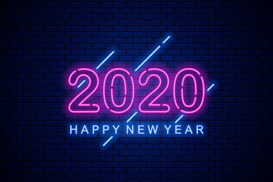 Happy 2020 new year. Neon greeting sign on dark brick background.