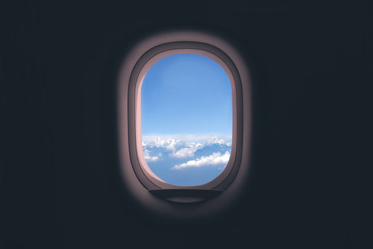 Airplane window. Mountain and clouds view