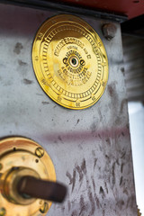 Historic name plate gear box of light house in South Africa