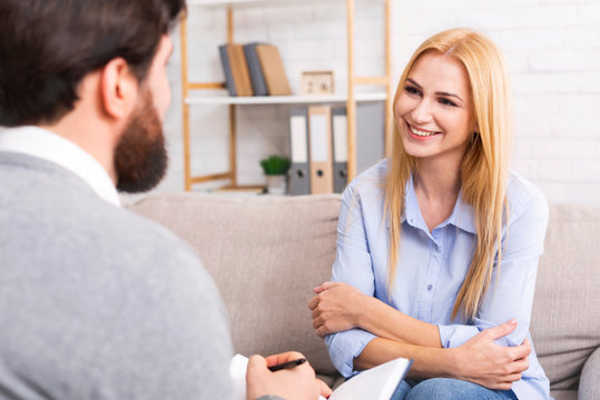 Friendly woman patient talking to psychological consultant