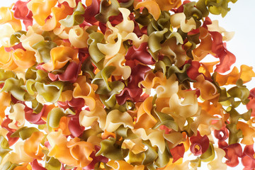 Italian pasta of three colors, red, green and yellow.