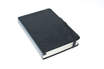 black notebook with rubber closure
