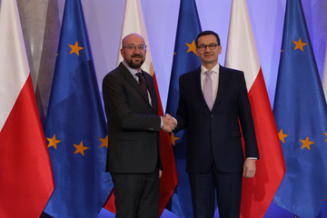 President-elect of European Council Charles Michel and Poland's Prime Minister Mateusz Morawiecki shake hands before their meeting in Warsaw