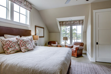 Beautiful upstairs bedroom with expensive furniture and view of a river.