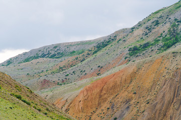 canyon with red sandy slopes. Desert hills with soil erosion, formation of ravines due to drought