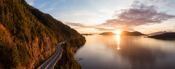 Wall Mural - Sea to Sky Hwy in Howe Sound near Horseshoe Bay, West Vancouver, British Columbia, Canada. Aerial panoramic view during a colorful sunset in Fall Season.