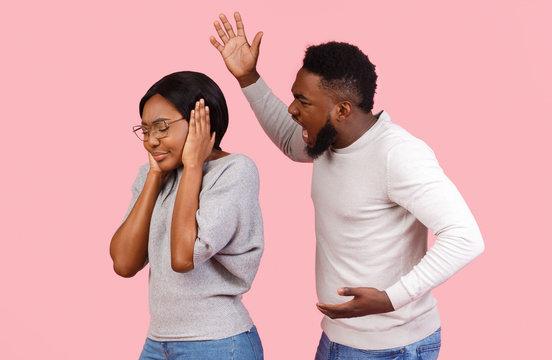 Violent black man shouting at his girlfriend