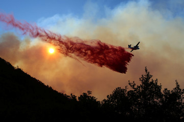 A wildfire dubbed the Cave Fire burns in the hills of Santa Barbara, California
