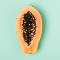 Fresh papaya isolated on mint background.