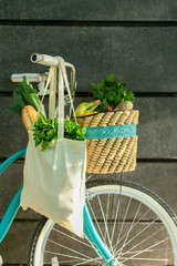 Bicycle with fresh products inside reusable shopping bags