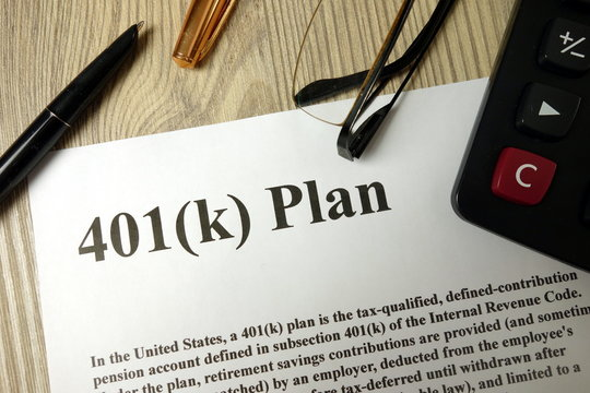 401k Plan with calculator pen and glasses