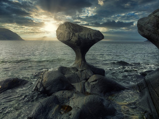 This particular sculpture in stone, shaped by the nature itself, stand in high-water mark in the villages Oppedal on the island Vågsøy.After roughened this 3 meter-high stone for thousands of years