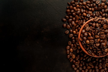 coffee beans on stone background, with copy space for your text