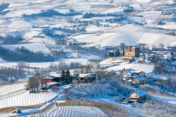Hills and vineyards of Langhe covered in snow in Italy.