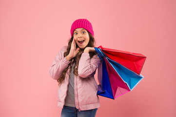 Christmas sale. Kid fashion. Holiday purchase saving. Home shopping. Small girl with shopping bags. Sales and discounts. Happy child. Little girl with gifts. Winter shopping. Buyer consumer concept