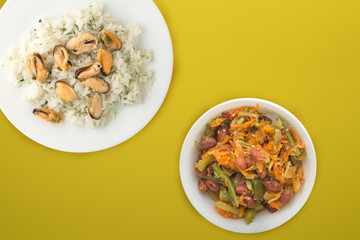 white rice with dill and mussels on a white plate. rice in vegetable salad on a colored background top view. Asian cuisine