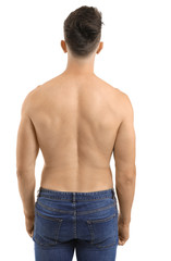 Young man with naked torso on white background, back view