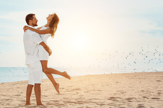 Happy couple resting at sea resort