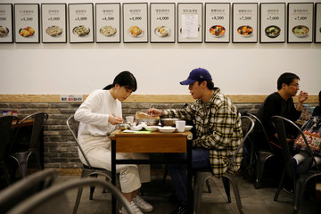 The Wider Image: No money, no hope: S. Korea's 'Dirt Spoons' turn against Moon