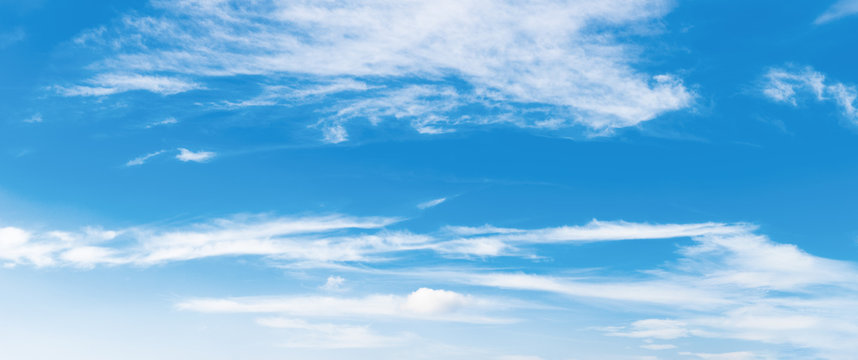azure sky panorama with puffy clouds. beautiful springtime nature background. dynamic side lit cloudscape