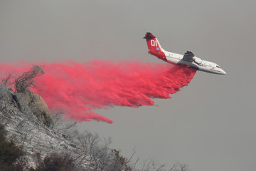 A wildfire dubbed the Cave Fire burns in the hills of Santa Barbara, California,