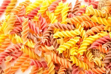 Tasty uncooked pasta on white background, closeup