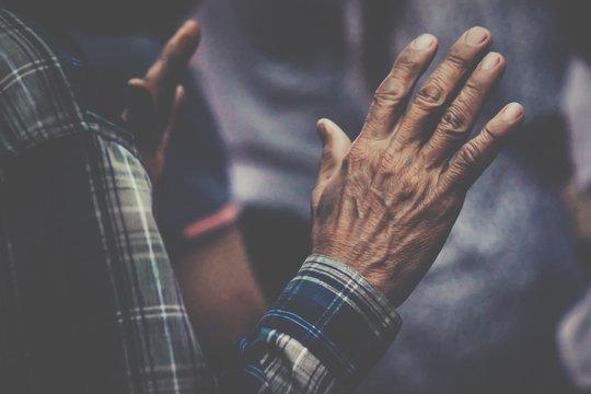 soft focus, Hand Praying and Praise at Church