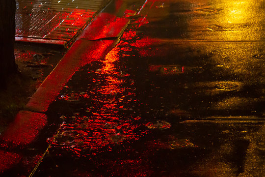 Rainy street with red light in Columbia City
