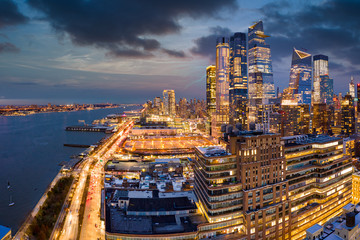 Fototapete - Aerial panorama of New York City skyscrapers at dusk as seen from above the 12th avenue and 26th street, close to Hudson Yards and Chelsea neighborhood