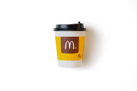 Bangkok ,Thailand - March 06 2019 : A paper cup of McDonald's Coffee on white background.