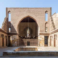 Main courtyard of public historic mosque of Sultan Al Nassir Qalawun with huge arch, Cairo, Egypt