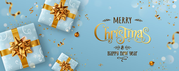 Fototapete - Gold Christmas and New Year Text on blue Xmas background with gift boxes, fir branches, gold ribbon, decoration, sparkles, confetti, bokeh. Merry Christmas card. Vector Illustration, realistic vector