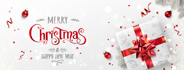 Fototapete - Red Christmas and New Year Text on Xmas background with gift boxes, fir branches, red ribbon, decoration, sparkles, confetti, bokeh. Merry Christmas card. Vector Illustration, realistic vector
