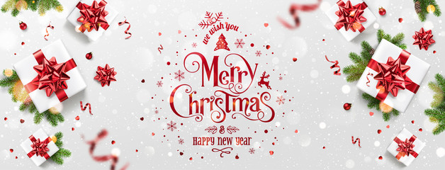 Fototapete - Red Christmas and New Year Text on Xmas background with gift boxes, fir branches, red ribbon, decoration, sparkles, confetti,bokeh