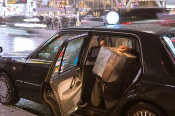 Japanese man getting into taxi at rainy night 雨の夜にタクシーに乗り込む男性