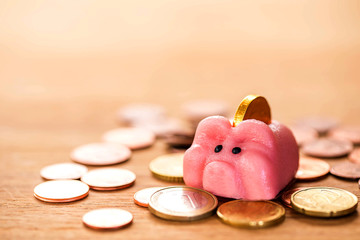 happy piggy bank on stack coins , image for saving money concept.