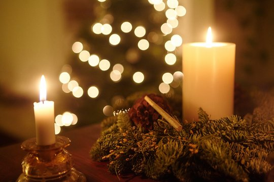 Closeup shot of a marijuana blunt among Christmas decorations and bokeh lights in the background