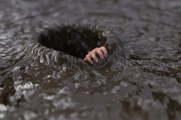 human hand clings to the edge of a hole