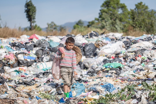 Poor boy collecting garbage in his sack to earn his livelihood, The concept of poor children and poverty