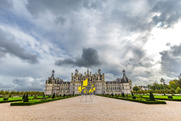 Chateau de Chambord, view from garden with dark clouds, in Loire valley, Centre Valle de Loire in France