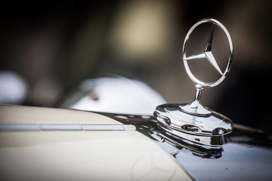 Mercedes Benz logo on a vintage car hood