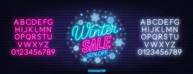Fototapete - Winter sale neon sign on dark background. Discount template. Neon alphabet on a dark background. Template for design.