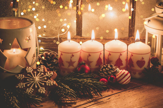 christmas candles and decorations on wooden background