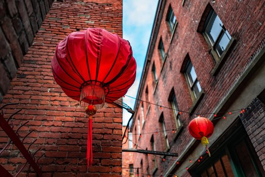 Low angle shot of Chinese lanterns in Fan Tan Alley, Chinatown, Victoria, BC Canada